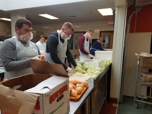 Team gets chopping on produce line.